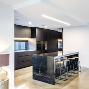 The new kitchen is not short on casual apartment, architecture, bar stool, building, cabinetry, ceiling, countertop, design, floor, flooring, furniture, glass, home, house, interior design, kitchen, lighting, loft, material property, property, real estate, room, table, tile, white