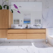 Marble look surfaces combine with the warmth of