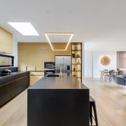 American white oak floors connect with the kitchen's