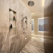 The ensuite features a tiled walk-through shower with