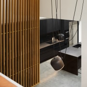 The kitchen's monolithic and minimalist look is punctuated