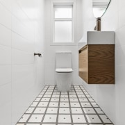 The toilet space in the home boasts the