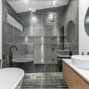 The shower stall reflections adds to the room's