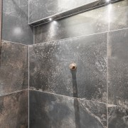 Character tiles, copper shower fittings and concealed niche