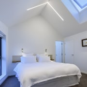 The master bedroom is tall, white and handsome