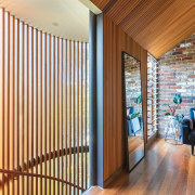 Pulling vertical circulation to the front of the architecture, ceiling, floor, flooring, hardwood, home, interior design, real estate, room, wall, window, window blind, window covering, window treatment, wood, brown