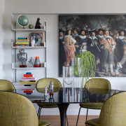 The dining area features Beetle dining chairs and