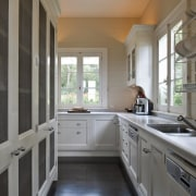 A scullery is tucked behind the cooking centre. cabinetry, countertop, cuisine classique, daylighting, floor, flooring, home, interior design, kitchen, property, real estate, room, window, gray