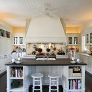 The kitchen is at one end of a ceiling, countertop, cuisine classique, home, interior design, kitchen, real estate, room, gray