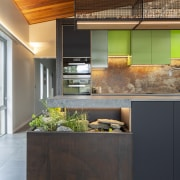 The kitchen includes a corner herb garden complete