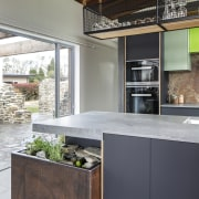 The kitchen is centrally set between two outdoor