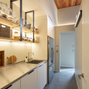 The creation of a walk-in pantry with the