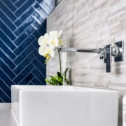 The rectangular tabletop vanity basin strikes a contemporary