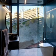 Touches like a cantilevered vanity and glass shower