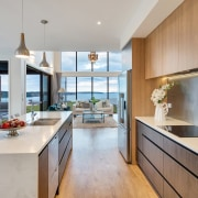 The modern open-plan kitchen has a butler's pantry,