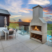 The open patio features a concrete Boston fireplace.