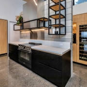 A blackened steel frame provides display shelving and