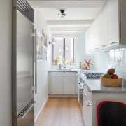 Within the now open-plan apartment, the kitchen has