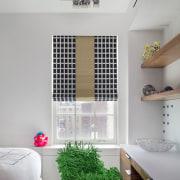 Both children's bedrooms feature large desks of acrylic