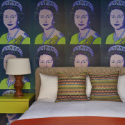 The studio is wallpapered with artworks, literally –
