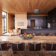 The home's substantial wood-lined kitchen and dining area.