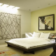 The master suite reflects a Japanese influence. The bed, bed frame, bedroom, ceiling, floor, furniture, home, interior design, mattress, room, wall, brown, yellow