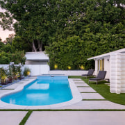 The home's elegant existing swimming pool. - Modest