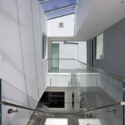 Large skylights in this atrium ensure the first architecture, ceiling, daylighting, glass, house, interior design, real estate, gray