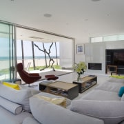 The light-filled living room in this contemporary beachfront architecture, house, interior design, living room, penthouse apartment, property, real estate, window, gray