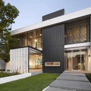 The main axis through this house is defined architecture, building, elevation, facade, home, house, property, real estate, residential area, siding, brown, white