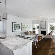 Wide plank oak floors ground this home's crisp, ceiling, countertop, estate, floor, flooring, home, house, interior design, kitchen, property, real estate, gray