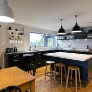 In renovating this family kitchen, designer Melanie Craig countertop, cuisine classique, interior design, kitchen, real estate, gray