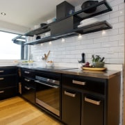 The powerpack above the cooktop in this renovated cabinetry, countertop, cuisine classique, floor, hardwood, interior design, kitchen, room, wood flooring, gray