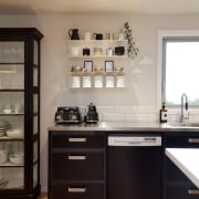 Designer Melanie Craig made steel the key material cabinetry, countertop, cuisine classique, floor, furniture, hardwood, home, home appliance, interior design, kitchen, room, gray