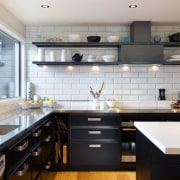 Steel was wrapped around the powerpack in this cabinetry, ceiling, countertop, cuisine classique, floor, flooring, hardwood, interior design, kitchen, room, gray