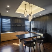A cove ceiling and pendants create a focal