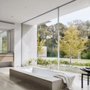 The dramatic master bath is ideally placed beside