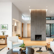 The existing immovable fireplace is treated like a