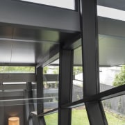 The steel fenestration of this feature window is architecture, glass, window, black, gray