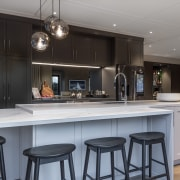 Modern mitred formwork combines with panelled cabinetry doors