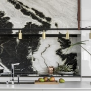 The dramatic splashback is a feature of the