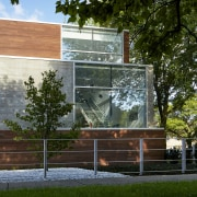 The exterior of this home comprises two materials architecture, building, facade, home, house, property, tree, black, brown
