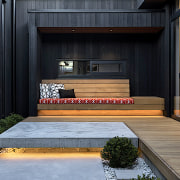 Courtyard steps are under-lit to dramatic effect in