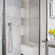 The master bathroom shower includes built in shelving