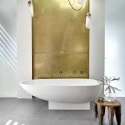 A nod to the home's exterior, a zinc-look