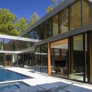 Sliding doors in the glass facade open the