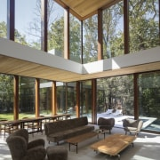 The double height family room overlooks the pool.