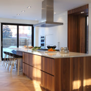 The contemporary kitchen includes classic elements, such as