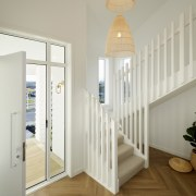 Even the stairwell includes windows on the home's