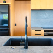 For this kitchen, the concrete-look and warm timber architecture, automotive exterior, countertop, door, floor, flooring, furniture, glass, interior design, material property, metal, room, table, vehicle door, wall, gray, orange